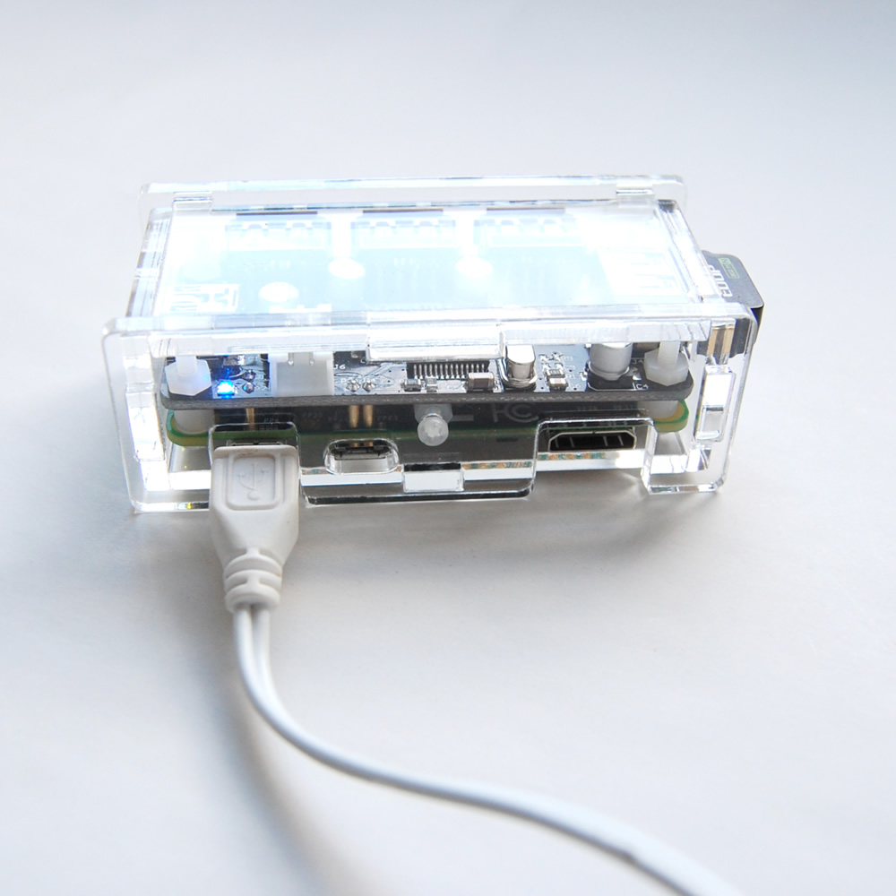 Acrylic case that holds Raspberry Pi Zero and Zero4U